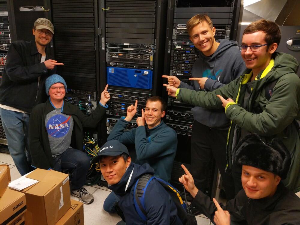 PLUG members in front of server